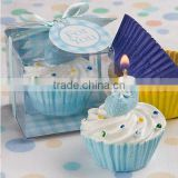 lovely blue cupcakes with baby shoes candle baby shower favors