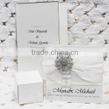 2016 newmengxing Fold type silver letterpress wedding invitation with brooch and ribbon, white and black theme