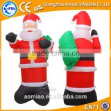 Air-blown inflatable santa grotto, inflatable christmas santa claus with gifts