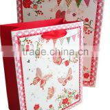 butterfly print 210gsm ivory paper bag with satin ribbon