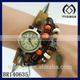 vintage brass tone alloy watch bracelet with rivet and wing charm