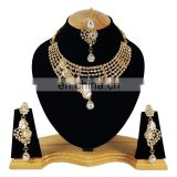 One Sided designer White Color Stone Gold Plated Kundan Zerconic Necklace Earrings Tikka