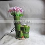 Resin bamboo table water fountain with flower decoration