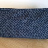 A multi pocket organizer bag in grey fabric for storage