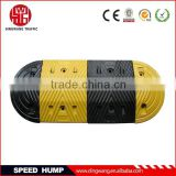 Yellow and black rubber road speed humps