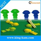 Silicone chopstick rest in kid shape