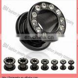 Titanium ear plug tunnel with black color and clear crystal
