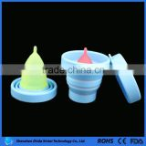 A set of lady silicone menstrual cup and silicone folding cup