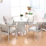 White pe rattan dining table set tempered glass table with four chairs
