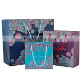 Luxury CMYK 250gsm C2S art paper material dress packaging paper bag