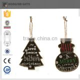 black wooden tree and snowman christmas decoration in home