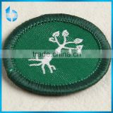 China label supplier custom low cost of woven fabric badge label for black rubber capeback coat