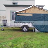 Australia standard off road hard floor camper trailer with 14 oz tent and kitchen system.