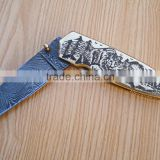 A BRASS HANDLE WITH ANGRY BEAR SCRIMSHAW HANDMADE DAMASCUS STEEL FIGHTING/ HUNTING KNIFE