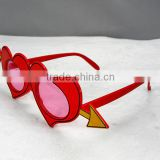 party glasses with one arrow piercing through two hearts