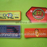 embossed customized logo soft pvc brand clothing labels/rubber garment label and tag