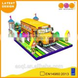 2015 AOQI latest design school bus model giant inflatable playground for kids for sale