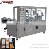 Widely Used Good Price Health Food Spice Cosmetic Box Packaging Equipment Condom Box Cellophane Overwrapping Machine