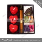 incense sticks cones and heart candles in bamboo holder
