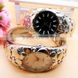 Studio time silver tone mother-of-pearl bangle watch for women