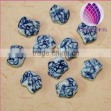 2015 whole sale artificial for DIY jewelry making Bead porcelain white and blue 13X15mm dragon shape 50pcs per bag