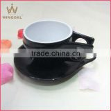 black and white porcelain coffee cup and saucer