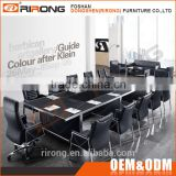 Latest custom made luxury modern black tempered glass top conference table with power outlet