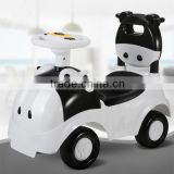 Hot sales CE approved children swing car,4 wheels cartoon cow children tricycle bicycle toys baby swing car with music