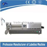 Table top filling machine for tin can or wine bottle