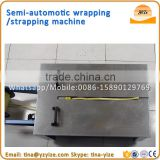 low Desk Semi automatic carton box Strapping Machine pp strapping roll making machine