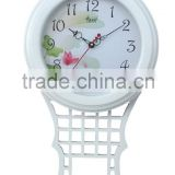 white wood frame wall clock pendulum