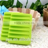 Green silicone soap shelf with groove by the sink