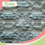 Factory direct supply warp knitted lace floral figures guipure lace fabric