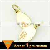 Fashion jewelry wholesale 11x6.5mm gold plating laser engraved logo custom metal jewelry tags