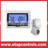 Programmable radiant wireless heating room thermostat