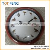 on time alarm wall clock hourly clock bird singing chirping hanging clock