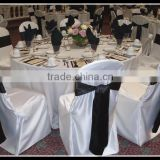 special events use white poly plain chair covers with black satin chair sashes