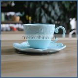 Beautiful lace blue ceramic coffee cup and saucer