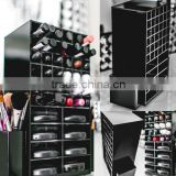 black rotating acrylic spinning lipstick tower