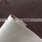 100 polyester bright color warp knitting leather look fabric for office chair, home furniture, trendy sofa cloth from china