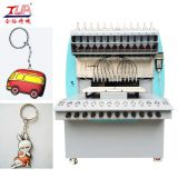 China dispensing soft plastic form keychain machine factory