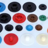 Plastic buttons for quick change disc/abrasive