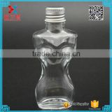 Fancy Design Woman Body Shaped Clear lotion Glass Bottle with aluminum cap