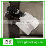 leather strap attached baggage tag crew