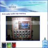 Full automatic 100 capsules per minute pure water Wine Big Bottle Cap Sealing Cork Equipment QY100-2