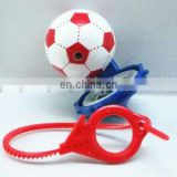 Plastic football shape spinning top toys