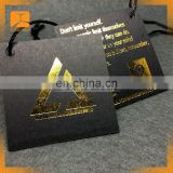 Hot sale custom black card paper hang tag/gold foil center folded swing tag