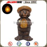 Cartoon characters kids present 7.3*6.9*14.2 cut wooden bear hugging honeycomb solar lights resin bear statue