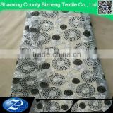 Cheap white african beaded tulle lace fabric for eveing dress styles with black circles                                                                                                         Supplier's Choice