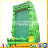 Green inflatable paintball wall with safety belt